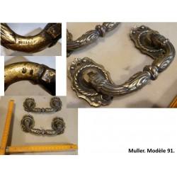 Paire de poignées en bronze. Muller, modèle 91